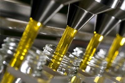 Polmonazione nella produzione di olio e di vino